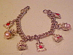 Click here to enlarge image and see more about item X5997: Charm bracelet with seven charms