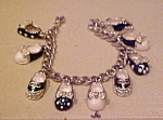 Click here to enlarge image and see more about item x6008: Charm bracelet with shoes