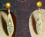 Celluloid earrings with vine design