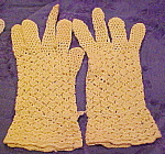 Yellow crocheted gloves