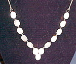 Click here to enlarge image and see more about item x6310: Mother of Pearl necklace