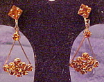 Click here to enlarge image and see more about item x6365: Topaz dangling rhinestone earrings