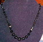 Click here to enlarge image and see more about item x6366: Black faceted glass bead necklace