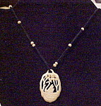 Celluloid necklace on black cord