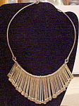 Click here to enlarge image and see more about item x6395: Silver fringe style necklace