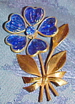 Click here to enlarge image and see more about item x6411: Retro flower pin with poured glass