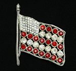 Click here to enlarge image and see more about item x6453: 1920s flag brooch