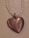 Heart locket on faux pearl necklace