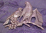 Pot metal double bird brooch