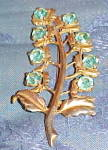 Leaf brooch with light blue rhinestones