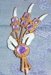 Flower brooch w/ enameling and purple stones