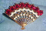 Click here to enlarge image and see more about item x6579: Trifari fan brooch with stones