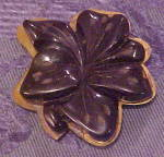 Click here to enlarge image and see more about item x6602: Bakelite dress clip