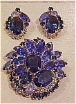 Blue rhinestone pin and earrings