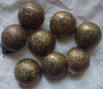 bag of goldtone plastic buttons.