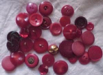 Bag of assorted red buttons