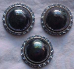 3 silvertone buttons with light blue rhinestone accents.
