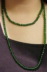 Czechoslovakian faceted green glass bead necklace.