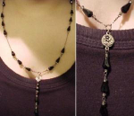 Black faceted glass Y necklace on silver chain