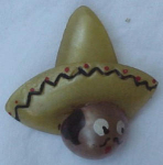 Celluloid mexican man in sombrero pin