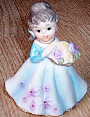 Girl With Flower Basket Figurine