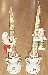 Pair Tilso Candle Holders Fairies Climbing on Candles (Image1)