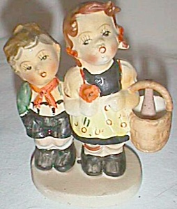 Old Boy And Girl Figurine Holding Basket