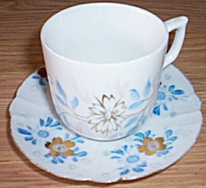 Antique Porcelain Cup And Saucer Blue Flowers