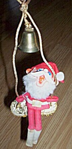 Vintage Rubber Santa on a Swing (Image1)