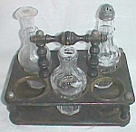 Click here to enlarge image and see more about item antstr-8: Antique Castor Set Very Unusual