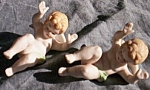 Click here to enlarge image and see more about item br-46: Vintage Pair Bisque Angels Laying