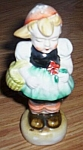 Click here to enlarge image and see more about item br-79: Occupied Japan Girl w/ Basket Shaker