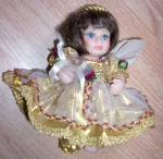 Click here to enlarge image and see more about item db-21: Adorable Little Bisque April Angel Doll