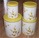 Click here to enlarge image and see more about item el-28: Vintage Tin Canister Set Yellow Blossoms & Tops