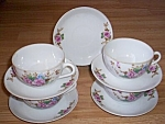 Click here to enlarge image and see more about item ev-15: 4 Occupied Japan Cups and Saucers Roses
