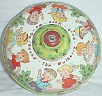 Click here to enlarge image and see more about item ole-213: Ohio Art Tin Toy Top Here We Go Round the Mulberry Bush