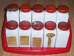 Click here to enlarge image and see more about item ole-767: 10 Vintage Spice Jars w/ Red Holder
