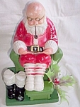 Click here to enlarge image and see more about item pen-47: Vintage Plastic Santa Reading His List