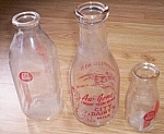 Click here to enlarge image and see more about item rum-383: Set of 3 Vintage City Dairy Milk Cream Bottles