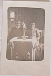 Click here to enlarge image and see more about item sn-64: Antique Photo Postcard? Elderly Couple Seated