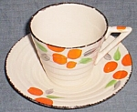 Click here to enlarge image and see more about item tw-56: Art Deco Cup & Saucer Ivory England Swinnertons