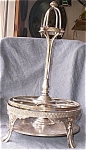 Click here to enlarge image and see more about item twig-105: Silver Plated Castor Stand John O. Mead