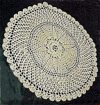 Click here to enlarge image and see more about item 1764: Dainty Crocheted Doily in Ecru