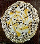 Click here to enlarge image and see more about item 1766: Pretty Bronze and White Crocheted Doily