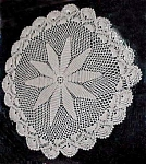 Click here to enlarge image and see more about item 1778: Beautiful Poinsettia-Like Center on Doily