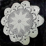 Click here to enlarge image and see more about item 1780: Lovely White 'Poinsettia' Doily