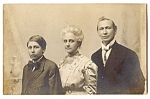 Click here to enlarge image and see more about item 2477: Early Real Photo Family Portrait