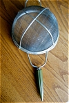 Click here to enlarge image and see more about item androck70521: Androck Bakelite Strainer