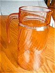 Click here to enlarge image and see more about item arcoroc110427a: Pink Swirl Glass Pitcher