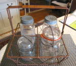 Click here to enlarge image and see more about item basketcarrier1215: Wire Basket and Vintage Jars
